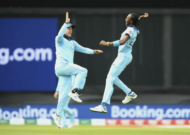 England's Jofra Archer, right, celebrates with teammate Jason Roy after taking the wicket of South Africa's Aiden Markram during their Cricket World Cup match at the Oval in London, Thursday, May 30, 2019. (Nigel French/PA via AP)