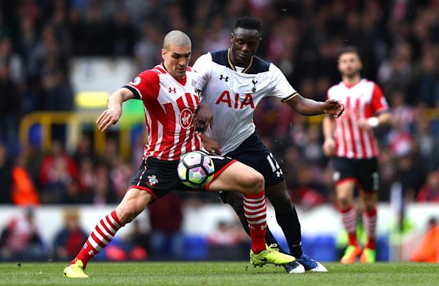 <p>Wanyama and Romeu clash in midfield </p>