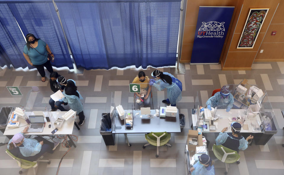 Texas-Rio Grande Valley's medical students help during a COVID-19 vaccination event at the medical school on Thursday, April 8,2021, in Edinburg, Texas. (Delcia Lopez/The Monitor via AP)