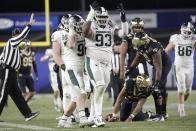 Michigan State defensive tackle Naquan Jones (93) and Jacub Panasiuk (96) celebrate after Wake Forest quarterback Jamie Newman (12) was sacked during the second half of the Pinstripe Bowl NCAA football game Friday, Dec. 27, 2019, in New York. (AP Photo/Frank Franklin II)
