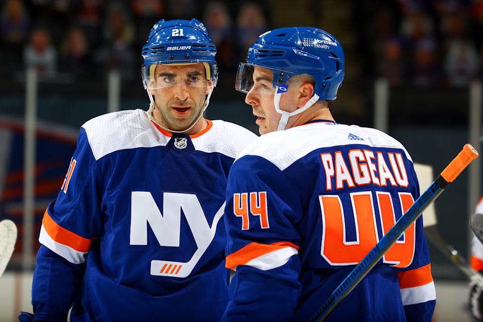 UNIONDALE, NEW YORK - APRIL 08:  Kyle Palmieri #21 of the New York Islanders speaks with Jean-Gabriel Pageau #44 during the first period against the Philadelphia Flyers at Nassau Coliseum on April 08, 2021 in Uniondale, New York. (Photo by Mike Stobe/NHLI via Getty Images)