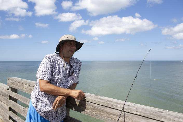Activist Rob Merlino at the beach in Venice, Fla., Oct. 15, 2018, where residents are still cautious about getting in the ocean water after a red tide was reported there in recent months. (Photo: Saul Martinez for Yahoo News)