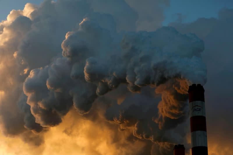 FILE PHOTO: Smoke and steam billow from Belchatow Power Station, Europe's largest coal-fired power plant operated by PGE Group, near Belchatow
