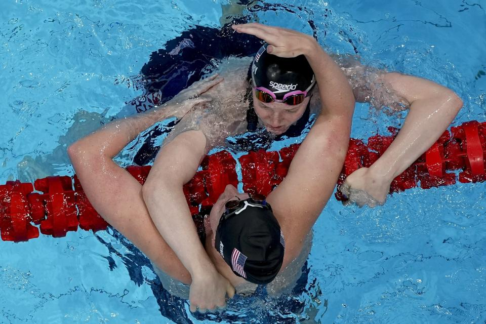 Lydia Jacoby, of the United States, is congratulated by teammate Lilly King after winning the gold in the final of the women's 100-meter breaststroke at the 2020 Summer Olympics, Tuesday, July 27, 2021, in Tokyo, Japan. King won the bronze. (AP Photo/Morry Gash)