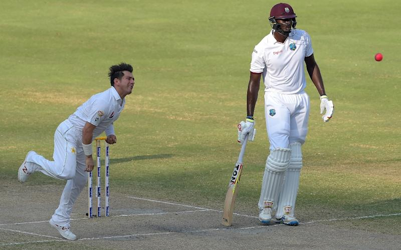 Yasir Shah (left) is among the fastest bowlers to take 100 wickets in all Test cricket (AFP Photo/Aamir Qureshi)