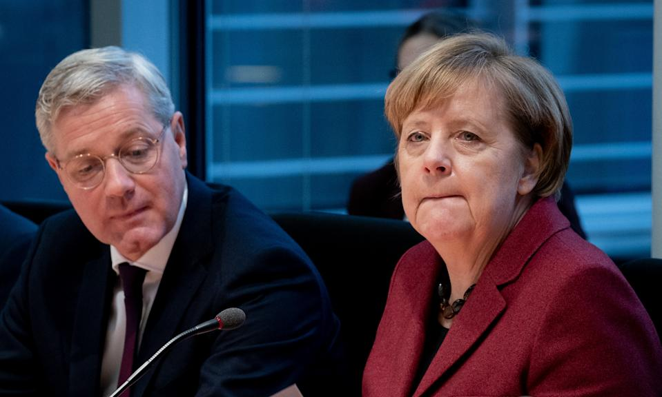 "German Chancellor Angela Merkel (R) and CDU politician and head of the committee Norbert Roettgen take part in a session of the Committee of Foreign Affairs of the Bundestag (lower house of parliament) on January 16, 2019 in Berlin. - Merkel said ""we still have time to negotiate"" after the British parliament overwhelmingly rejected Prime Minister's deal on leaving the European Union. (Photo by Kay Nietfeld / dpa / AFP) / Germany OUT        (Photo credit should read KAY NIETFELD/DPA/AFP via Getty Images)"