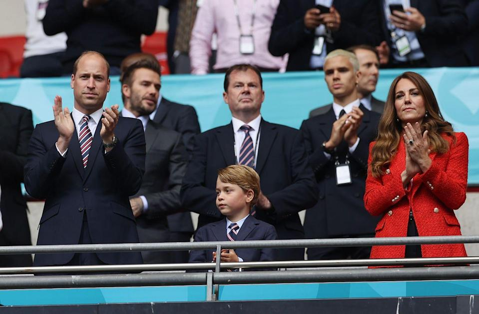 """<p>The Duchess of Cambridge attended the England versus Germany soccer match, wearing a <a href=""""https://go.redirectingat.com?id=74968X1596630&url=https%3A%2F%2Fwww.zara.com%2Fus%2Fen%2Ftextured-double-breasted-blazer-p02410564.html&sref=https%3A%2F%2Fwww.townandcountrymag.com%2Fstyle%2Ffashion-trends%2Fnews%2Fg1633%2Fkate-middleton-fashion%2F"""" rel=""""nofollow noopener"""" target=""""_blank"""" data-ylk=""""slk:red Zara blazer"""" class=""""link rapid-noclick-resp"""">red Zara blazer</a>. Prince William and Prince George joined Kate at Wembley Stadium. </p>"""
