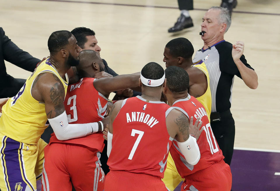 Rajon Rondo and Chris Paul came to blows in the Houston Rockets' victory against the Los Angeles Lakers on Saturday. (AP)