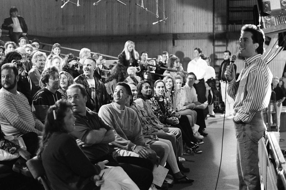 <p>The sitcom was taped in front of a live studio audience. Here, Seinfeld is seen warming up the crowd before taping an episode. </p>