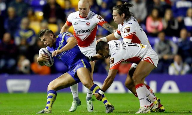 "<span class=""element-image__caption"">Matty Russell, left, here against St Helens last season, scored three tries for Warrington in their 22-22 draw at home to Hull FC.</span> <span class=""element-image__credit"">Photograph: Ed Sykes/Reuters</span>"