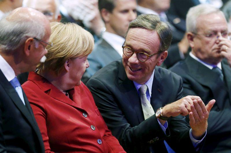 File photo of German Chancellor Merkel talking to President of the VDA Wissmann during the official opening of the Frankfurt Motor Show (IAA) in Frankfurt