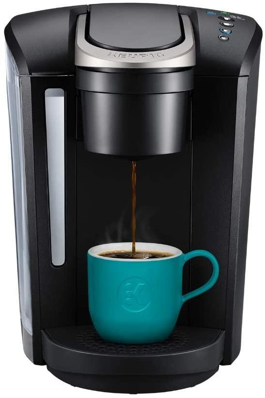 """<h2>Keurig K-Select Coffee Maker</h2><br><br><strong>Keurig</strong> Single Serve K-Cup Pod Coffee Brewer, $, available at <a href=""""https://amzn.to/3j23myW"""" rel=""""nofollow noopener"""" target=""""_blank"""" data-ylk=""""slk:Amazon"""" class=""""link rapid-noclick-resp"""">Amazon</a>"""