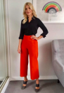 """<p>Holly teamed red trousers by Karen Millen with a black shirt from <a rel=""""nofollow noopener"""" href=""""https://www.winserlondon.com/"""" target=""""_blank"""" data-ylk=""""slk:Winser London"""" class=""""link rapid-noclick-resp"""">Winser London</a> for one episode of 'This Morning'. </p>"""