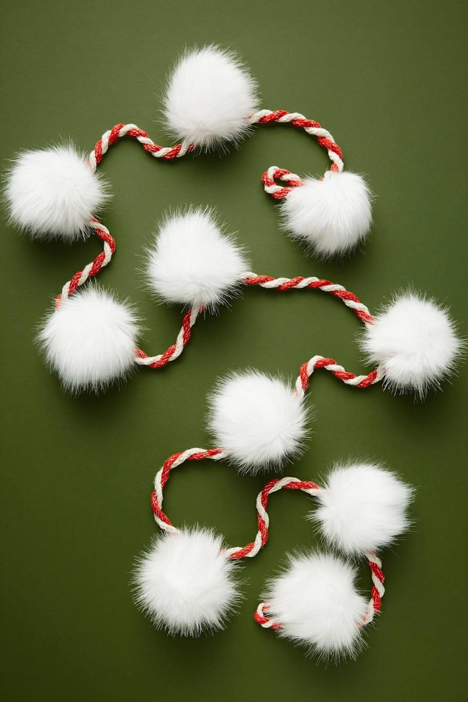 """<p>Not only does the <a href=""""https://www.popsugar.com/buy/Candy-Cane-Garland-490543?p_name=Candy%20Cane%20Garland&retailer=anthropologie.com&pid=490543&price=38&evar1=casa%3Aus&evar9=46615300&evar98=https%3A%2F%2Fwww.popsugar.com%2Fhome%2Fphoto-gallery%2F46615300%2Fimage%2F46615414%2FCandy-Cane-Garland&list1=shopping%2Canthropologie%2Choliday%2Cchristmas%2Cchristmas%20decorations%2Choliday%20decor%2Chome%20shopping&prop13=mobile&pdata=1"""" rel=""""nofollow noopener"""" class=""""link rapid-noclick-resp"""" target=""""_blank"""" data-ylk=""""slk:Candy Cane Garland"""">Candy Cane Garland</a> ($38) represent our favorite holiday candy, but its pom-poms give us a very Dr. Seuss vibe.</p>"""