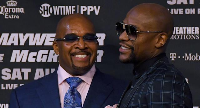 Mayweather Promotions CEO Leonard Ellerbe and Floyd Mayweather Jr. talk during a news conference at the KA Theatre at MGM Grand Hotel & Casino on Aug. 23, 2017 in Las Vegas, Nevada. (Getty Images)