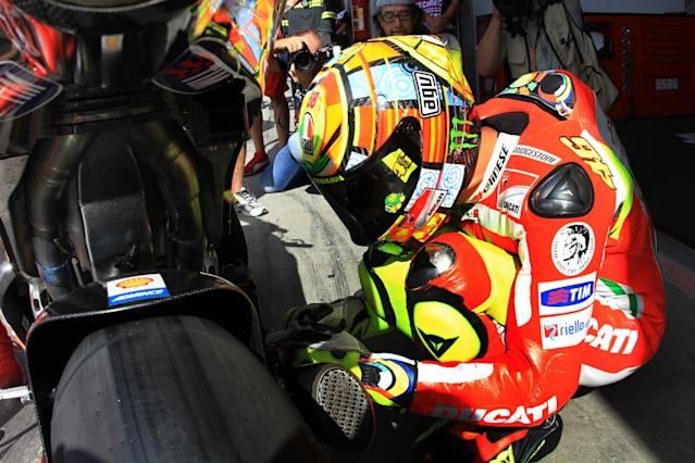 Moto GP rider Valentino Rossi of Italy prepares to take part in a free practice session at the Czech Republic Grand Prix in Moto GP on August 24, 2012 in Brno ahead of the Grand prix event on August 26. AFP PHOTO / RADEK MICARADEK MICA/AFP/GettyImages