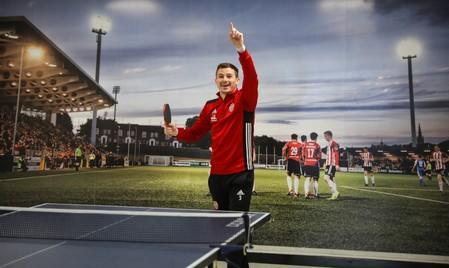 Derry City player Ciaran Coll reacts after winning a game of table tennis at the club's gym facility in Londonderry, Northern Ireland