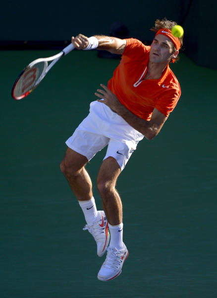 Roger Federer, of Switzerland, serves to Ivan Dodig, of Croatia, during their match at the BNP Paribas Open tennis tournament, Monday, March 11, 2013, in Indian Wells, Calif. (AP Photo/Mark J. Terrill)