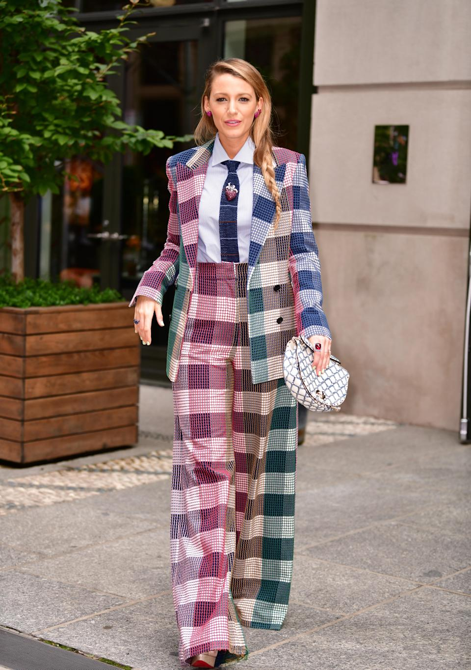 <p>The actress met up with her co-star Anna Kendrick in a plaid Roland Mouret suit. <em>[Photo: Getty]</em> </p>