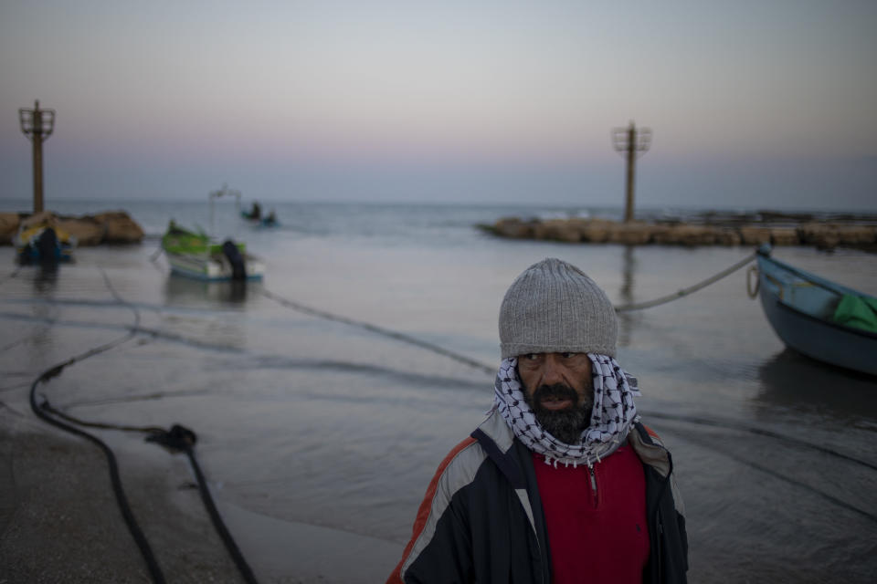 A local fisherman who goes by the name Jumbo returns from a fishing trip on the Mediterranean Sea, in the Israeli Arab village of Jisr al-Zarqa, Israel, in the early morning of Thursday, Feb. 25, 2021. After weathering a year of the coronavirus pandemic, an oil spill in the Mediterranean whose culprits remain at large delivered another blow for the fishermen of Jisr al-Zarqa. (AP Photo/Ariel Schalit)