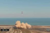 The SpaceX Starship SN9 prototype rocket lifts off for a test flight from its launch pad in Boca Chica