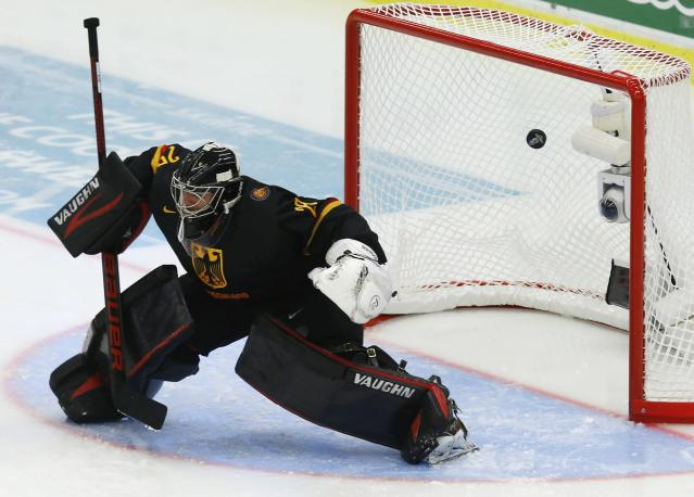 Germany's goalie Anthony Stolarz lets the puck into his net during the second period of the IIHF World Junior Championship ice hockey game against the U.S. team in Malmo, Sweden, December 29, 2013. REUTERS/Alexander Demianchuk (SWEDEN - Tags: SPORT ICE HOCKEY)
