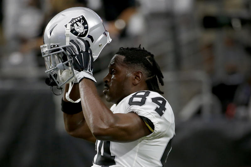 Raiders' Brown practices; National Football League reportedly flunks helmet