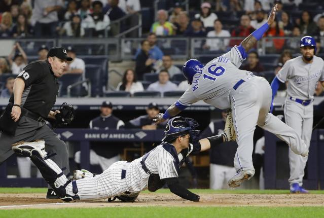 New York Yankees catcher Kyle Higashioka, center, tags out Kansas City Royals' Martin Maldonado at home plate as referee James Williams, left, watches during the third inning of a baseball game Friday, April 19, 2019, in New York. (AP Photo/Frank Franklin II)