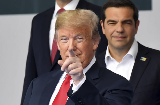 <p>President Trump points his finger during a group photo at a summit of heads of state at NATO headquarters in Brussels on July 11, 2018. NATO leaders gathered in Brussels for a two-day summit to discuss Russia, Iraq and their mission in Afghanistan. (Photo: Geert Vanden Wijngaert/AP) </p>
