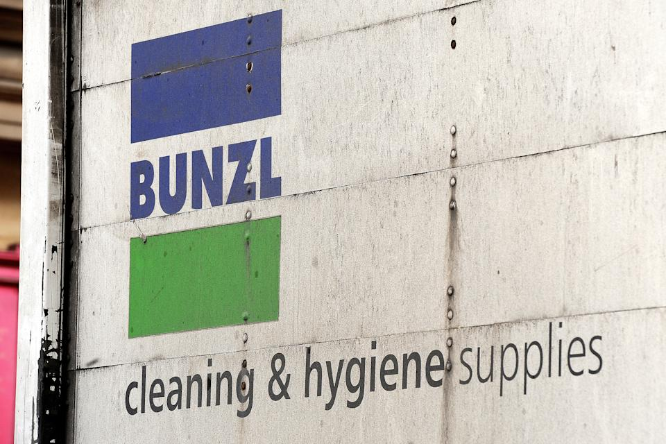 A general view of the BUNZL logo on the side of a van in the City of London.