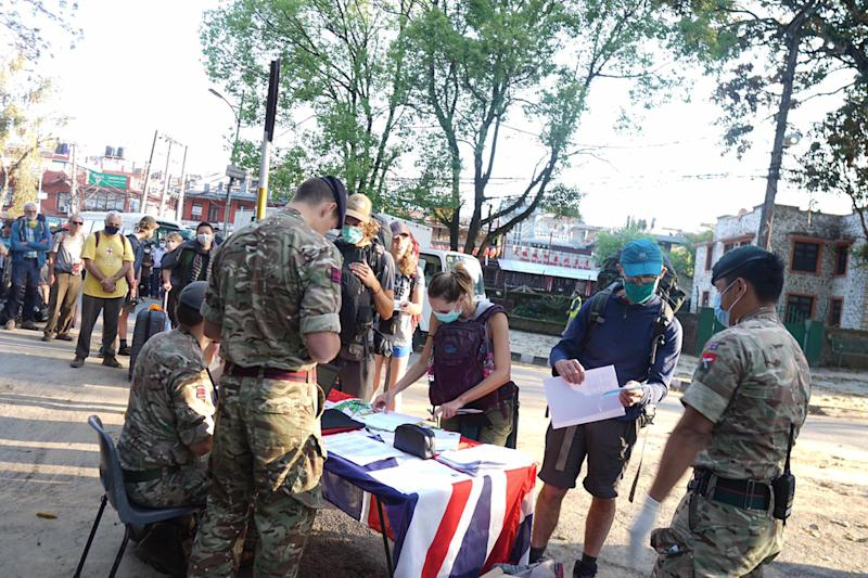More than 100 British travellers stranded in isolated parts of Nepal when the coronavirus outbreak struck and have been rescued by the Gurkhas. (Picture: PA)