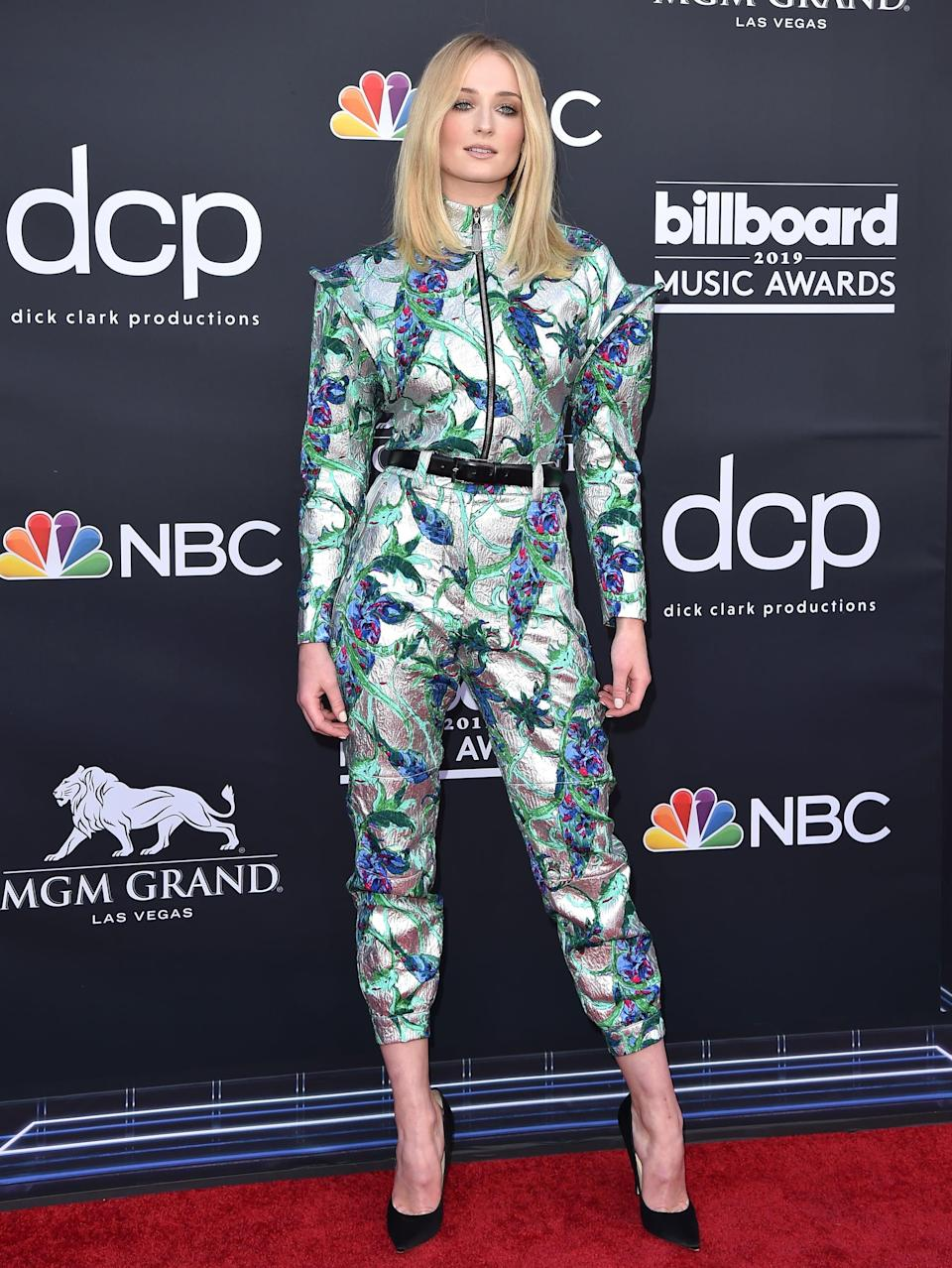 <p>Some refer to it as her space age suit, but the jacquard, zipper-front jumper Sophie wore to the 2019 Billboard Music Awards was straight off the runway and accessorized minimally with tall Jimmy Choo Anouk pumps.</p>