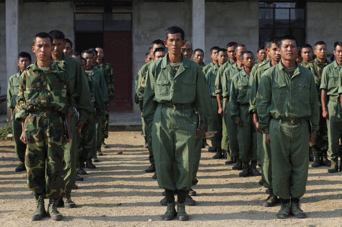 In this Feb. 13, 2012, file photo, recruits of the Kachin Independence Army, one of the country's largest armed ethnic groups, receive training at a military camp near Laiza. the area controlled by the Kachin in northern Myanmar. The Kachin Independence Army claims to have shot down a helicopter belonging to the government's military Monday, May 3, 2021, in the course of heavy fighting over a strategic position. (AP Photo/Vincent Yu, File)