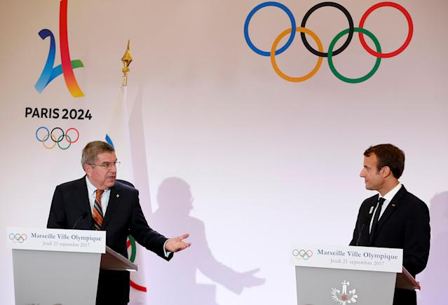 French President Emmanuel Macron (R) and President of the International Olympic Committee (IOC) Thomas Bach (L) attend a press conference during their visit at the future site of the sailing for the 2024 Summer Olympic Games in Marseille, France, September 21, 2017. REUTERS/Sebastien Nogier/Pool