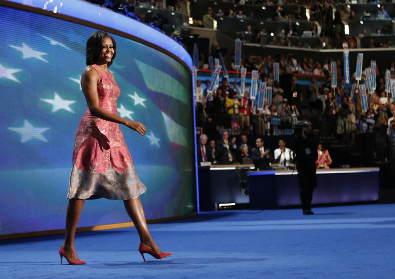 FILE - In this Tuesday, Sept. 4, 2012 file photo, first lady Michelle Obama walks onto the stage wearing a Tracy Reese dress at the Democratic National Convention in Charlotte, N.C. (AP Photo/Jae C. Hong, File)