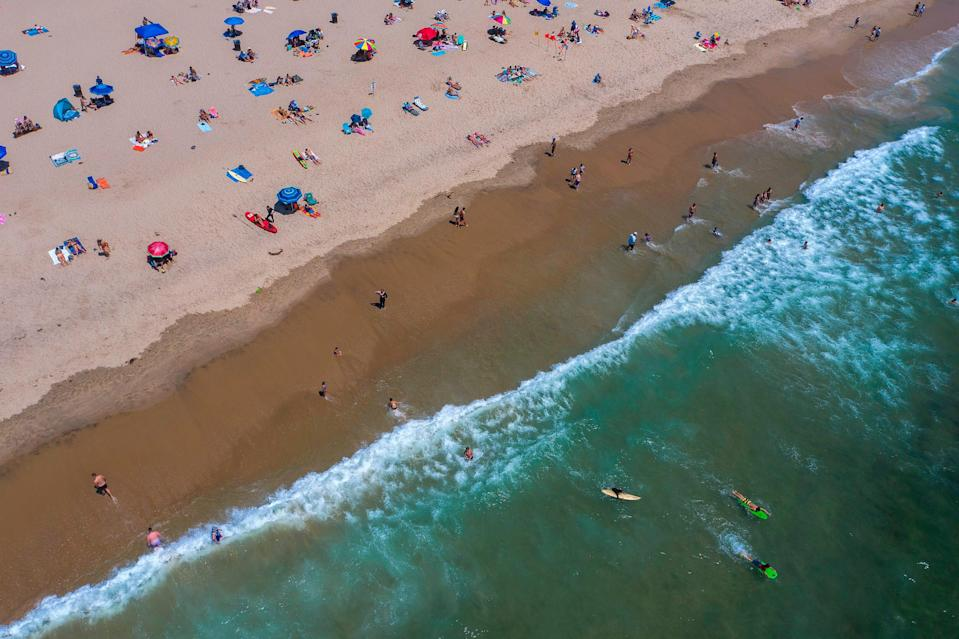An aerial view of Hermosa Beach, Calif., shows a sparsely populated beach on July 12, 2020.