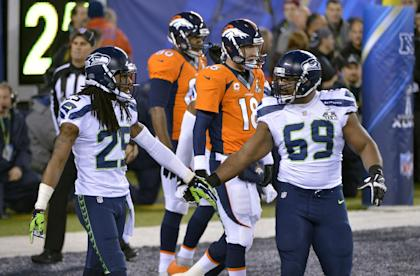The Seahawks defense, led by cornerback Richard Sherman (25) led the way in a Super Bowl XLVIII win (AP)