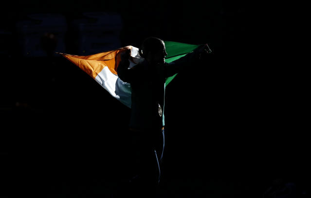 Gold medallist Katie Taylor of Ireland carries her country's flag during the presentation ceremony for the Women's Light (60kg) boxing competition at the London Olympic Games August 9, 2012. REUTERS/Damir Sagolj (BRITAIN - Tags: OLYMPICS SPORT BOXING TPX IMAGES OF THE DAY)