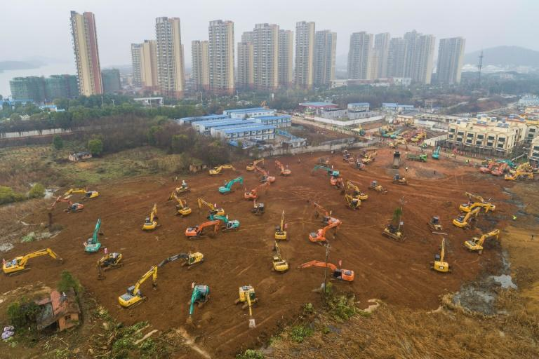Workers toiled day and night amid a forest of earthmovers and trucks carting goods around the site, southwest of the centre of the city of 11 million