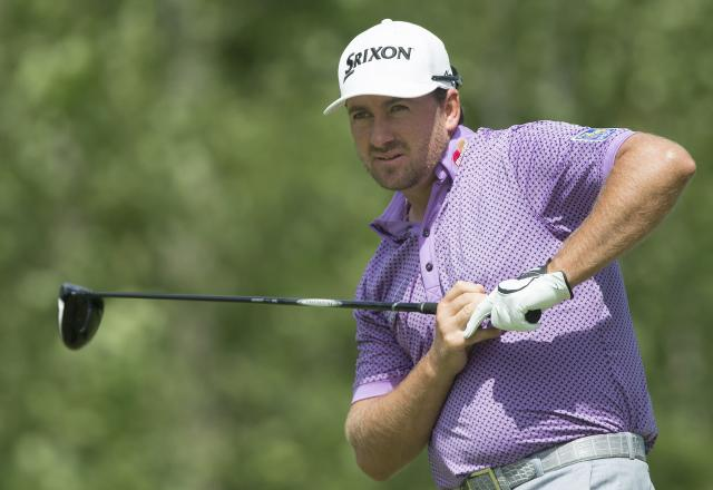 Graeme McDowell looks down the fairway after teeing off on the fourth hole during the third round of the Canadian Open golf championship at the Royal Montreal Golf Club in Montreal, Saturday, July 26, 2014. (AP Photo/The Canadian Press, Graham Hughes)