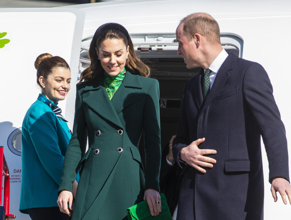 The Duke and Duchess of Cambridge walk down the steps of the plane as they arrive at Dublin International Airport ahead of their three day visit to the Republic of Ireland.