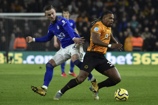Wolverhampton Wanderers' Adama Traore, right, fights for the ball with Leicester's James Maddison during the English Premier League soccer match between Wolverhampton Wanderers and Leicester City at the Molineux Stadium in Wolverhampton, England, Friday, Feb. 14, 2020. (AP Photo/Rui Vieira)