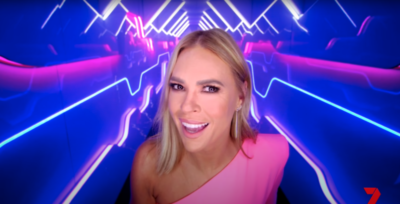 Sonia Kruger wearing a pink dress in the promo for Big Brother