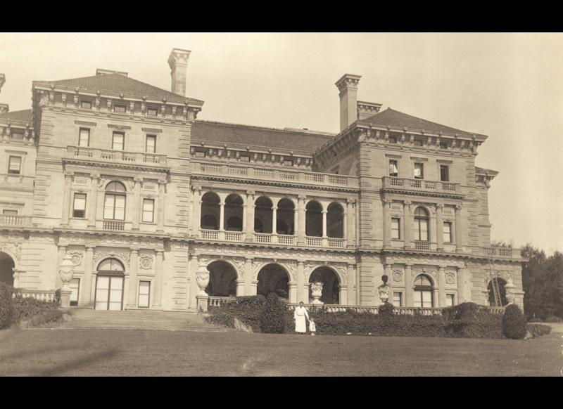 Gloria and her nurse Dodo in front of The Breakers following her father' death in 1925