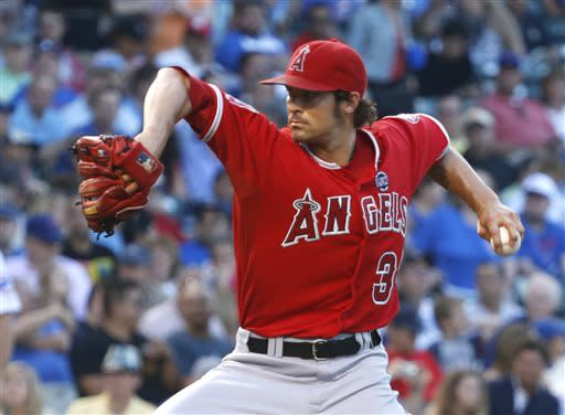 Los Angeles Angels starting pitcher C.J. Wilson delivers during the first inning of an interleague baseball game against the Chicago Cubs on Wednesday, July 10, 2013, in Chicago. (AP Photo/Charles Rex Arbogast)