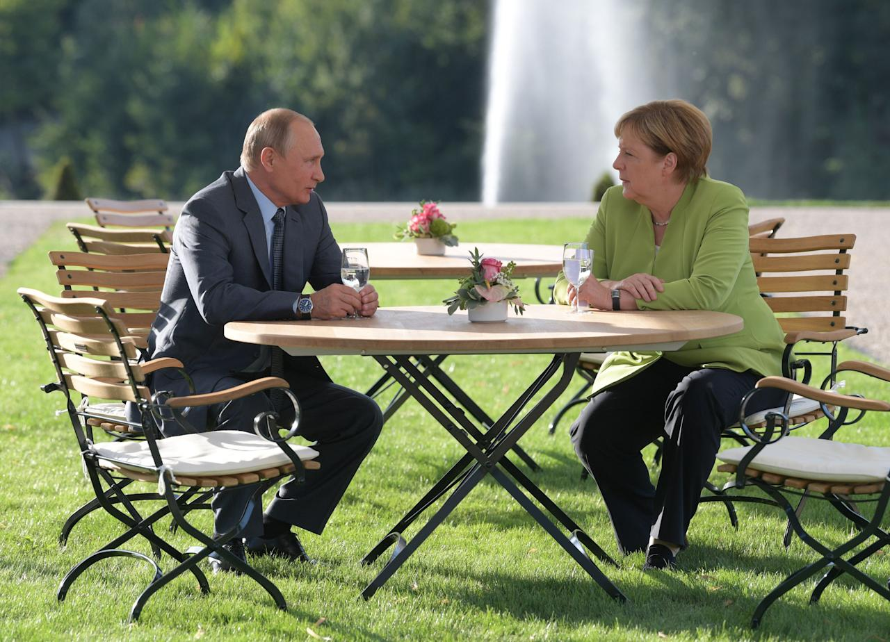 Merkel was hosting Putin for their first bilateral talks in Germany since 2013