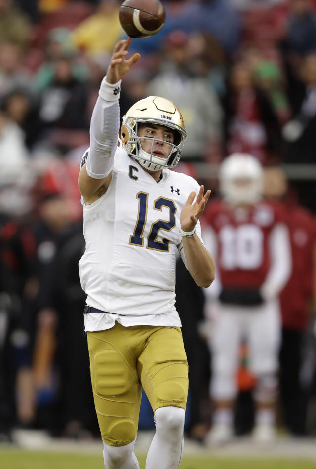 Notre Dame quarterback Ian Book passes against Stanford in the first half of an NCAA college football game Saturday, Nov. 30, 2019, in Stanford, Calif. (AP Photo/Ben Margot)