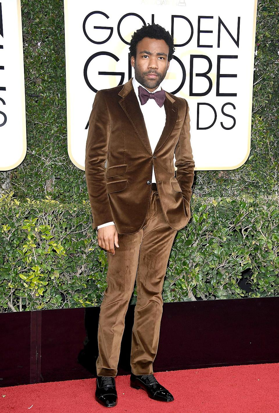 <p>Wearing a brown velvet suit by Gucci. [Photo: Getty] </p>
