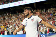 United States' Ricardo Pepi (16) celebrates with teammates after scoring his second goal against Jamaica during a FIFA World Cup qualifying soccer match, Thursday, Oct. 7, 2021, in Austin, Texas. (AP Photo/Eric Gay)