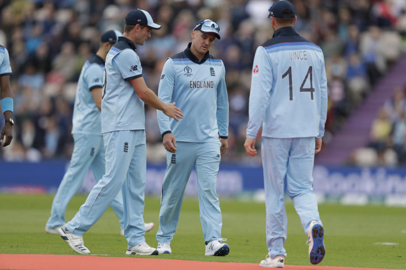 England's Jason Roy, centre, walks off the field of play with a leg injury during the Cricket World Cup match between England and West Indies at the Hampshire Bowl in Southampton, England, Friday, June 14, 2019. (AP Photo/Matt Dunham)